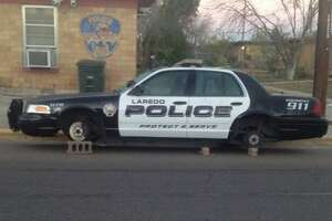 A Laredo police car sits on cinder blocks after two tires were stolen at the Colonia Guadalupe substation.