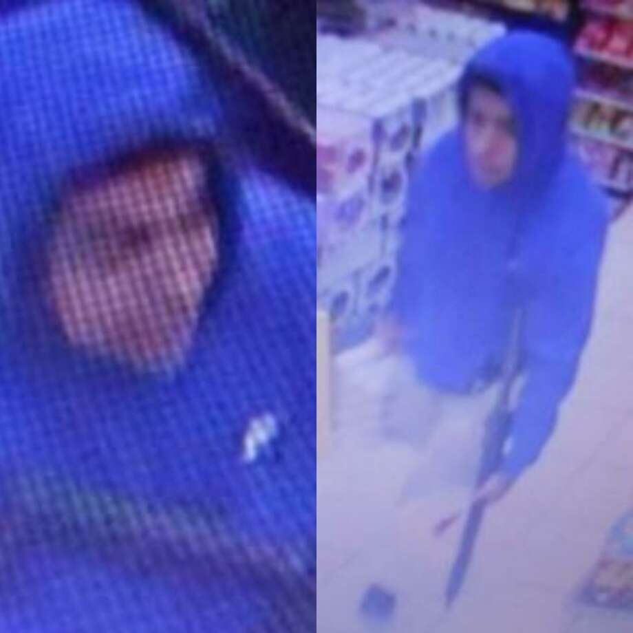 A man is seen in still images carrying a rifle during an alleged robbery at a convenience store. Photo: Courtesy Of The Montgomery County Sheriff's Office