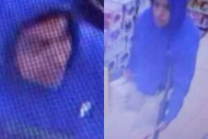 A man is seen in still images carrying a rifle during an alleged robbery at a convenience store.
