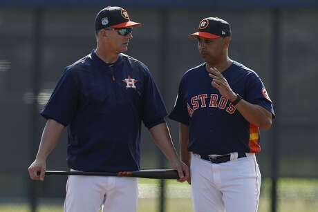Astros manager A.J. Hinch (left) was suspended for a year while former bench coach and current Red Sox skipper Alex Cora's discipline is still be determined by MLB commissioner Rob Manfred.