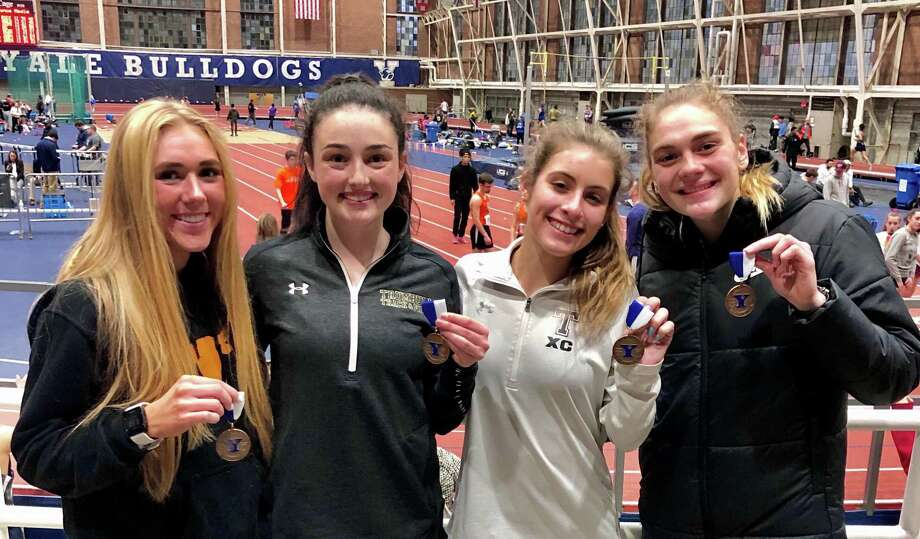 The 4x800 relay team made up of Kali Holden, Carolyn Cardell, Ally Zaffina and Emily Alexandru placed fourth, and Alexandru won the 600-meter race, in the 38th Yale Interscholastic Track Classic. Photo: Contributed Photo / Trumbull High Athletics / Trumbull Times