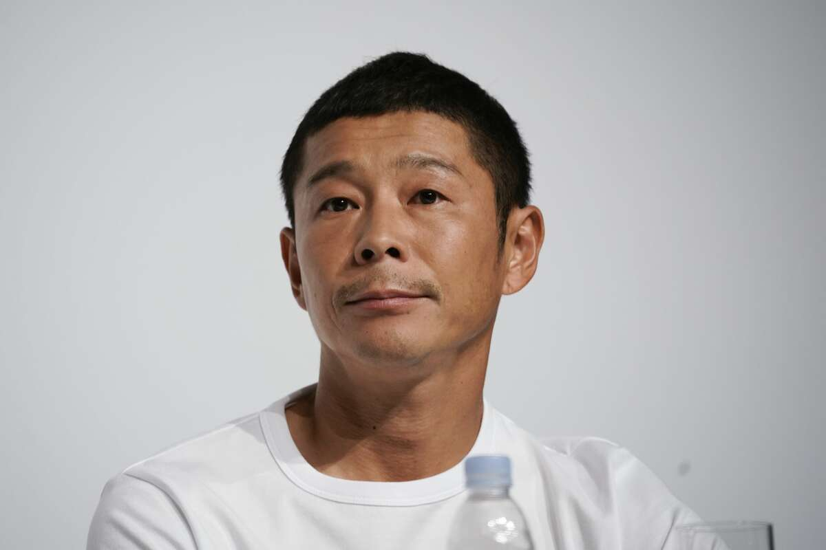 Zozo founder Yusaku Maezawa attends a news conference Thursday, Sept. 12, 2019, in Tokyo. Yahoo Japan Corp. said Thursday, Sept. 12, 2019 it will put up a tender offer, estimated at 400 billion yen ($3.7 billion), for Zozo Inc., a Japanese online retailer started by a celebrity tycoon. (AP Photo/Jae C. Hong)