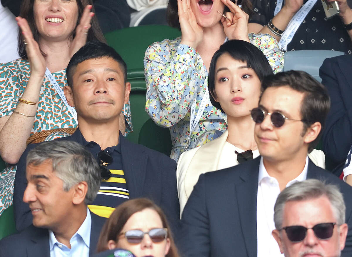 Yusaku Maezawa and Ayame Goriki on Centre Court on Men's Finals Day of the Wimbledon Tennis Championships at All England Lawn Tennis and Croquet Club on July 14, 2019 in London.
