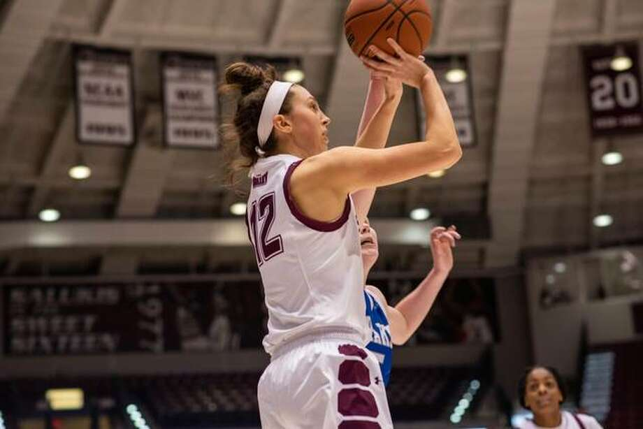 SIUC guard and EHS grad Makenzie Silvey scored 1,000th career point on Sunday in a loss to Drake. Photo: SIUC Athletics
