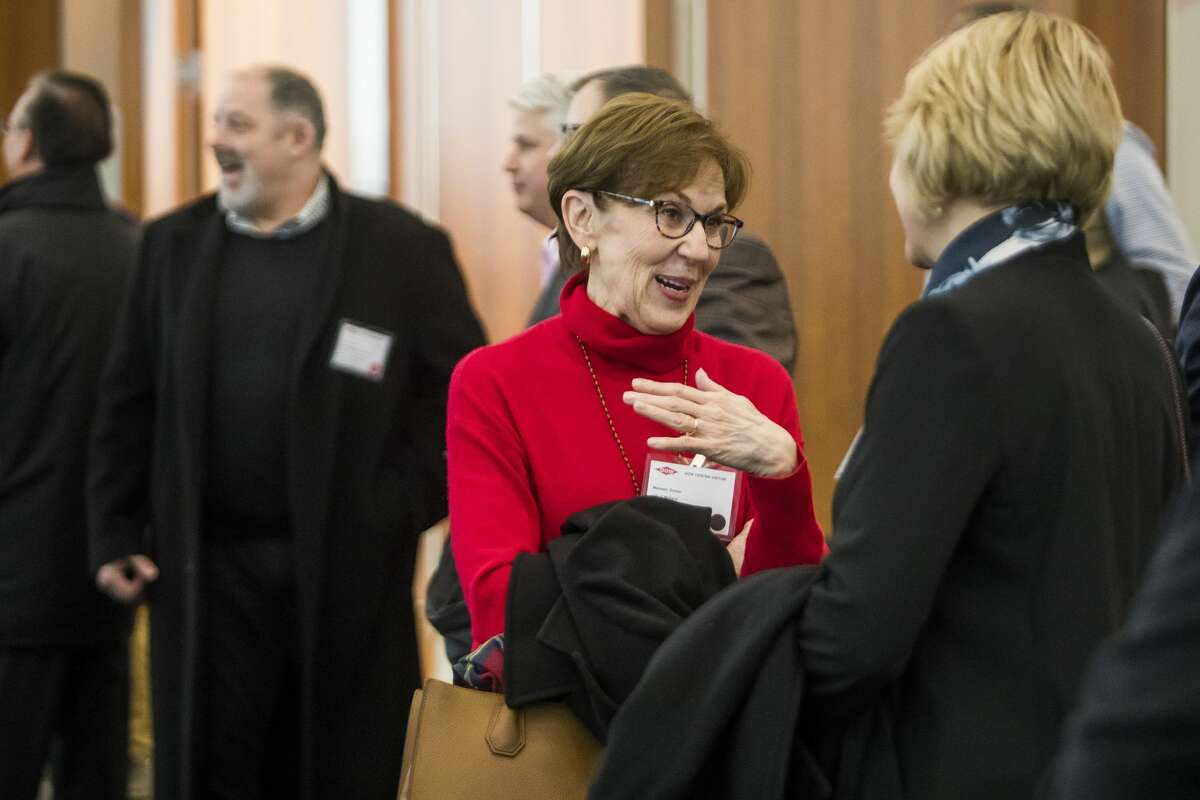 Mayor Maureen Donker chats with other guests before the grand opening of the Sylvia Stoesser Center on the Willard H. Dow Campus Monday, Jan. 13, 2020 in Midland. (Katy Kildee/kkildee@mdn.net)