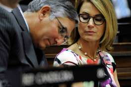In a file photo, Senate Minority Leader Len Fasano, R-North Haven, left, sat in the State Capitol during a joint session of the House and Senate, with House Minority Leader Themis Klarides, R-Derby.