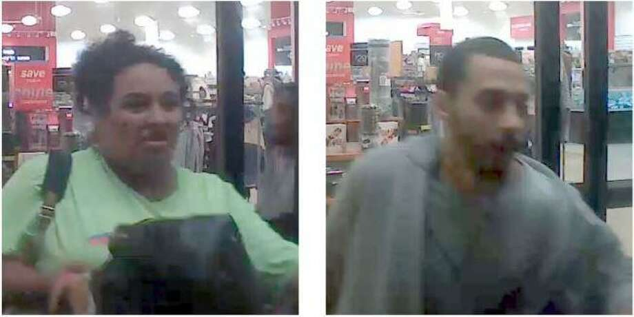 A man and woman are seen walking out of a TJ Maxx in New Caney after allegedly stealing about $2,000 in handbags. Photo: Courtesy Of The Montgomery County Sheriff's Office