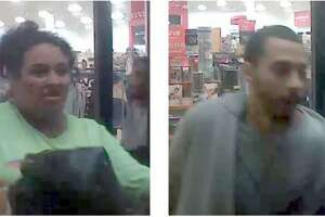 A man and woman are seen walking out of a TJ Maxx in New Caney after allegedly stealing about $2,000 in handbags.