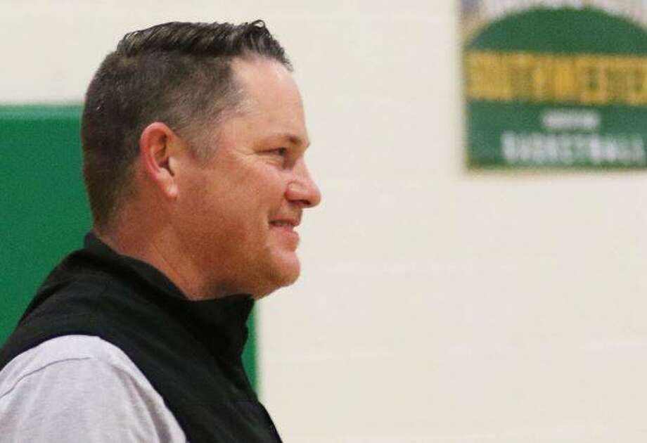 Jason Isringhausen, a 1990 Southwestern graduate and 2019 St. Louis Cardinals Hall of Fame inductee, walks onto the court at Southwestern on Friday night to join former teammates from the 1990 Piasa Birds baseball team.
