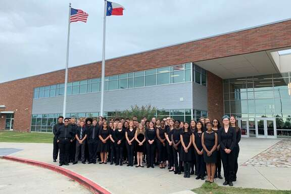 The Crosby High School band stands in front of Crosby High School