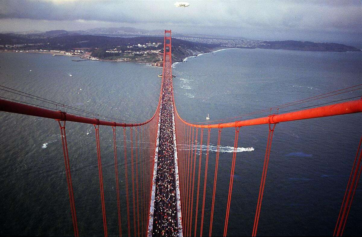 50th Anniversary of the Golden Gate Bridge on May 22, 1987. hundreds of thousands people walked on the traffic lanes of the bridge, as it was closed to traffic all day. View is from the top of the south tower looking north to Ft. Point.