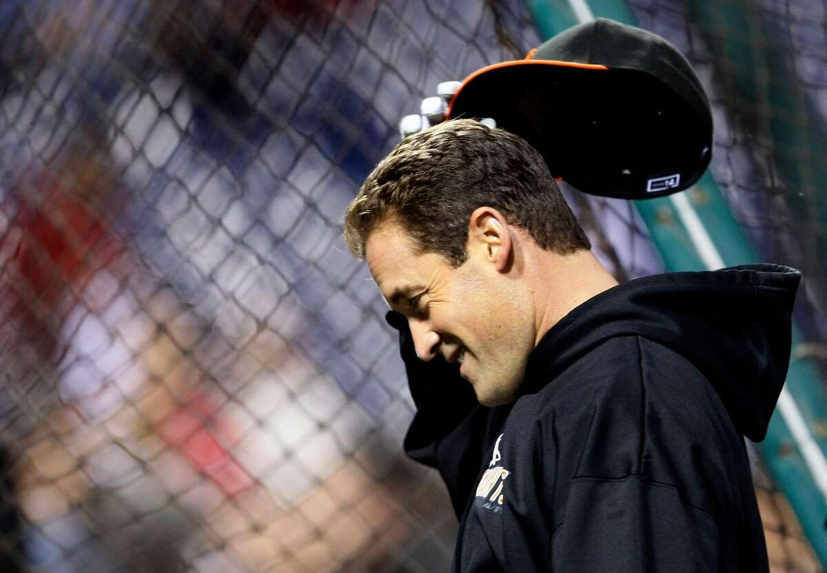 The Giants' Pat Burrell keeps loose outside the batting cage during team warmups prior to Game 6 against the Phillies in the NLCS on Saturday at Citizens Bank Park in Philadelphia.