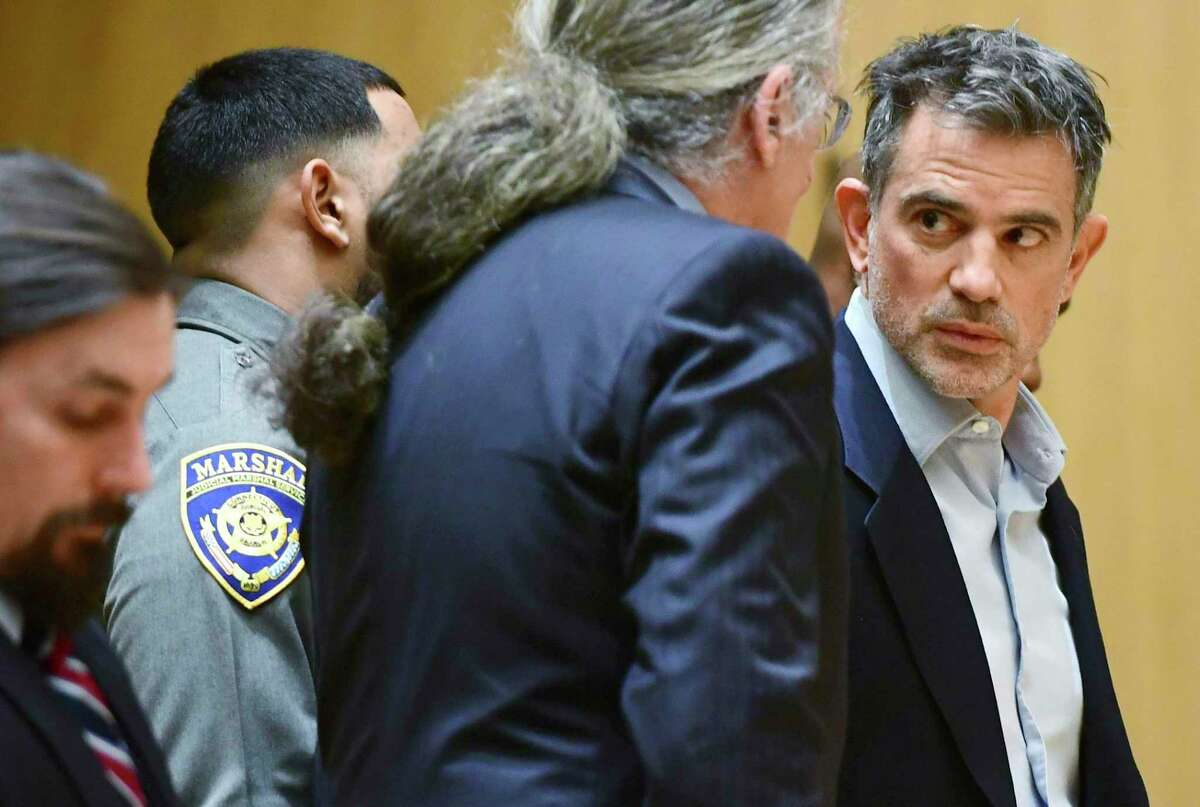 Fotis Dulos, the estranged husband of a missing mother of five, is arraigned on murder and kidnapping charges in Stamford Superior Court Wednesday, Jan. 8, 2020, in Stamford, Conn.