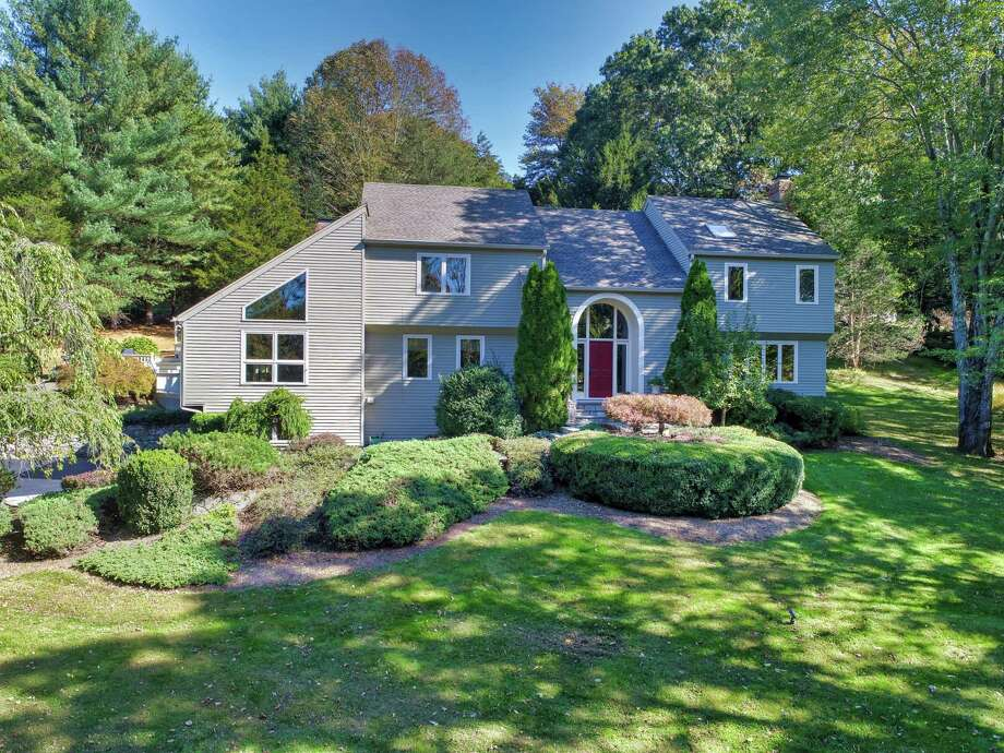 The gray colonial house at 16 11 O'Clock Road in Weston features 10 rooms and 4,343 square feet of living and entertaining space with a contemporary flair.