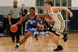 New Caney point guard Zion Childress (2) leads the Eagles in scoring at 13.3 points per game.