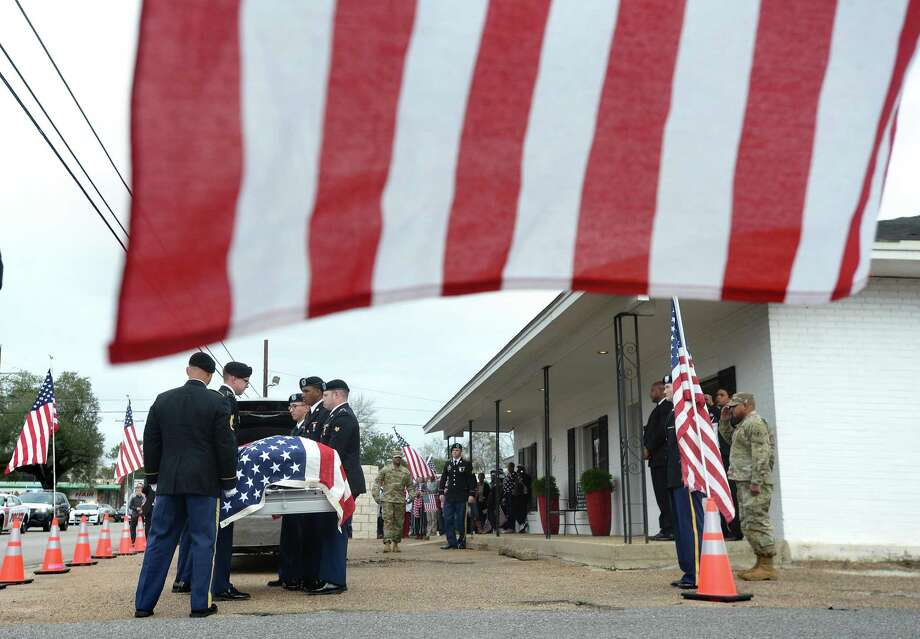 A military honor guard carry Jacoby McFarland's flag-draped casket into Coleman Family Mortuary in Woodville, where his body was transported after arriving from Schofield Military Base in Hawaii. Area residents and school children carrying flags and signs of support lined S. Magnolia St. to await the Patriot Guard-led procession carrying Jasper native Jacoby McFarland. McFarland was a U.S. Army Specialist based in Hawaii when he passed. In his nearly 7 years of service, he had overseas tours in Afghanistan and Korea.  Photo taken Monday, Jan. 13, 2020 Kim Brent/The Enterprise Photo: Kim Brent / The Enterprise / BEN
