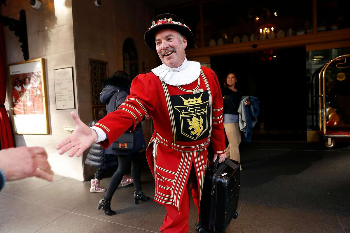 Beefeater doorman Tom Sweeney greets a hotel guest during the final day of his 43 year long career at the Sir Francis Drake Hotel in San Francisco, Calif., on Sunday, January 12, 2020.