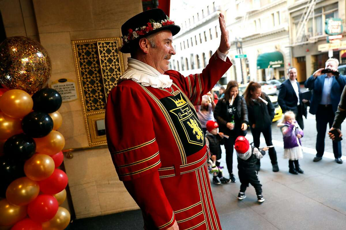 Beefeater doorman Tom Sweeney waves as his family blows horns at the end of his shift on the final day of his 43 year long career at the Sir Francis Drake Hotel in San Francisco, Calif., on Sunday, January 12, 2020.
