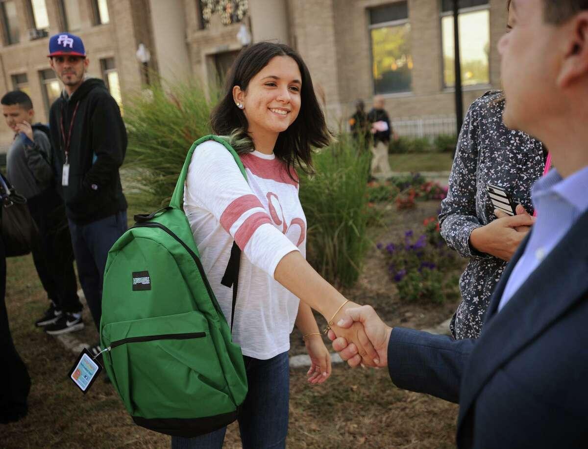 Maria Marrero, 17, from Carolina, Puerto Rico, shakes hands with Bridgeport Mayor Joe Ganim after receiving a school backpack outside City Hall in Bridgeport, Conn. on Thursday, October 5, 2017. Marrero will be attending Bassick High School.