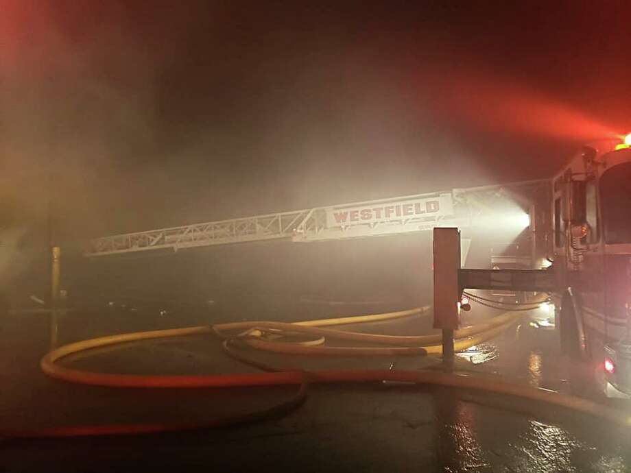 Firefighters knocked down a massive blaze at the All-American Waste transfer station off Industrial Park Road Sunday morning in Middletown. Photo: Westfield Fire Department Photo