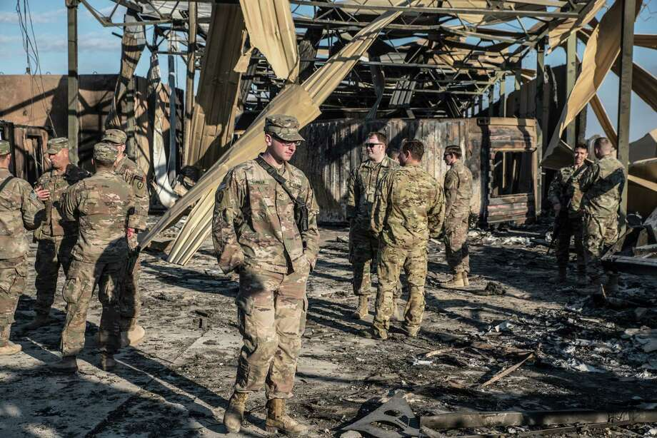 U.S. officials stand near an installation damaged by Iranian airstrikes inside the Ain al-Asad base near Anbar, Iraq, on Jan. 13, 2019. Photo: Photo For The Washington Post By Emilienne Malfatto / The Washington Post