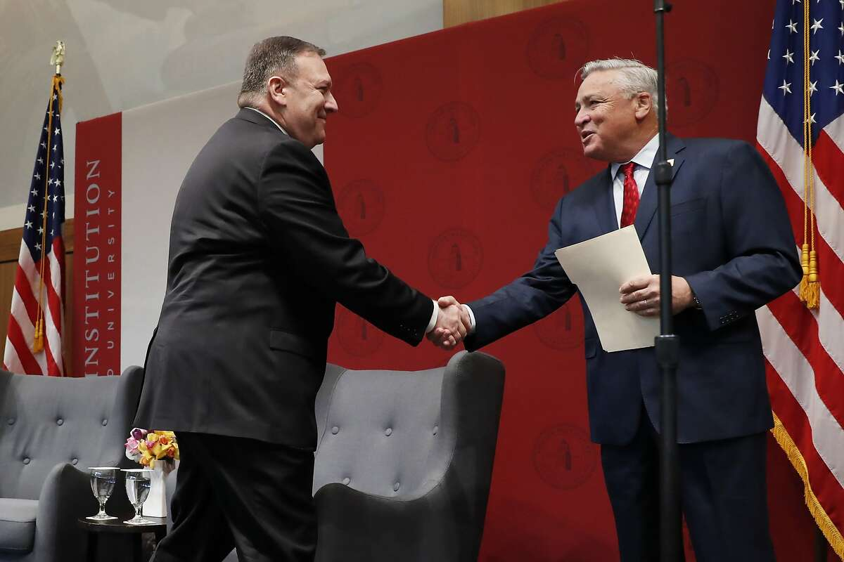Secretary of State Mike Pompeo, left, shakes hands with Hoover Institution Director Thomas W. Gilligan after being introduced to speak during an event hosted by the institution at Stanford University in Stanford, Calif., Monday, Jan. 13, 2020. (John G. Mabanglo/Pool Photo via AP)