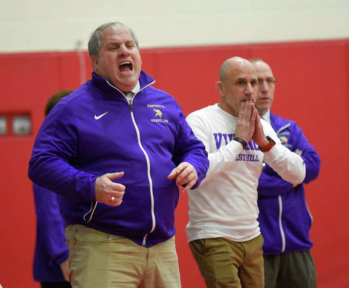 Westhill coach Mike Cigala shouts to a wrestler during a wrestling match at Greenwich High School on Jan. 8, 2020 in Greenwich. Conn.