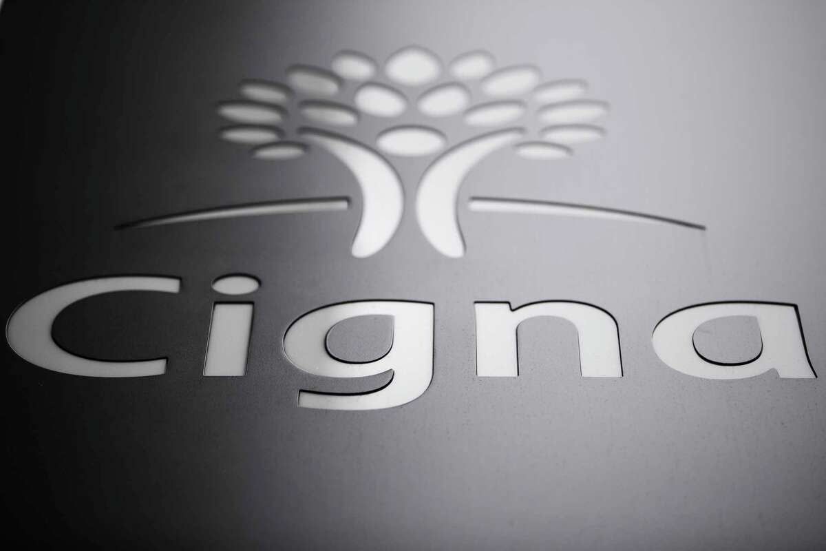 FILE - This Nov. 26, 2018, file photo shows the Cigna Corp., logo at the headquarters of the health insurer in Philadelphia. New York Life will spend more than $6 billion in cash to buy the group life and disability coverage business of the insurer Cigna. The life insurer said Wednesday, Dec. 18, that the deal will add millions of customers to its business. It also gives Cigna Corp. cash to buy back stock and pare its debt. (AP Photo/Matt Rourke, File)