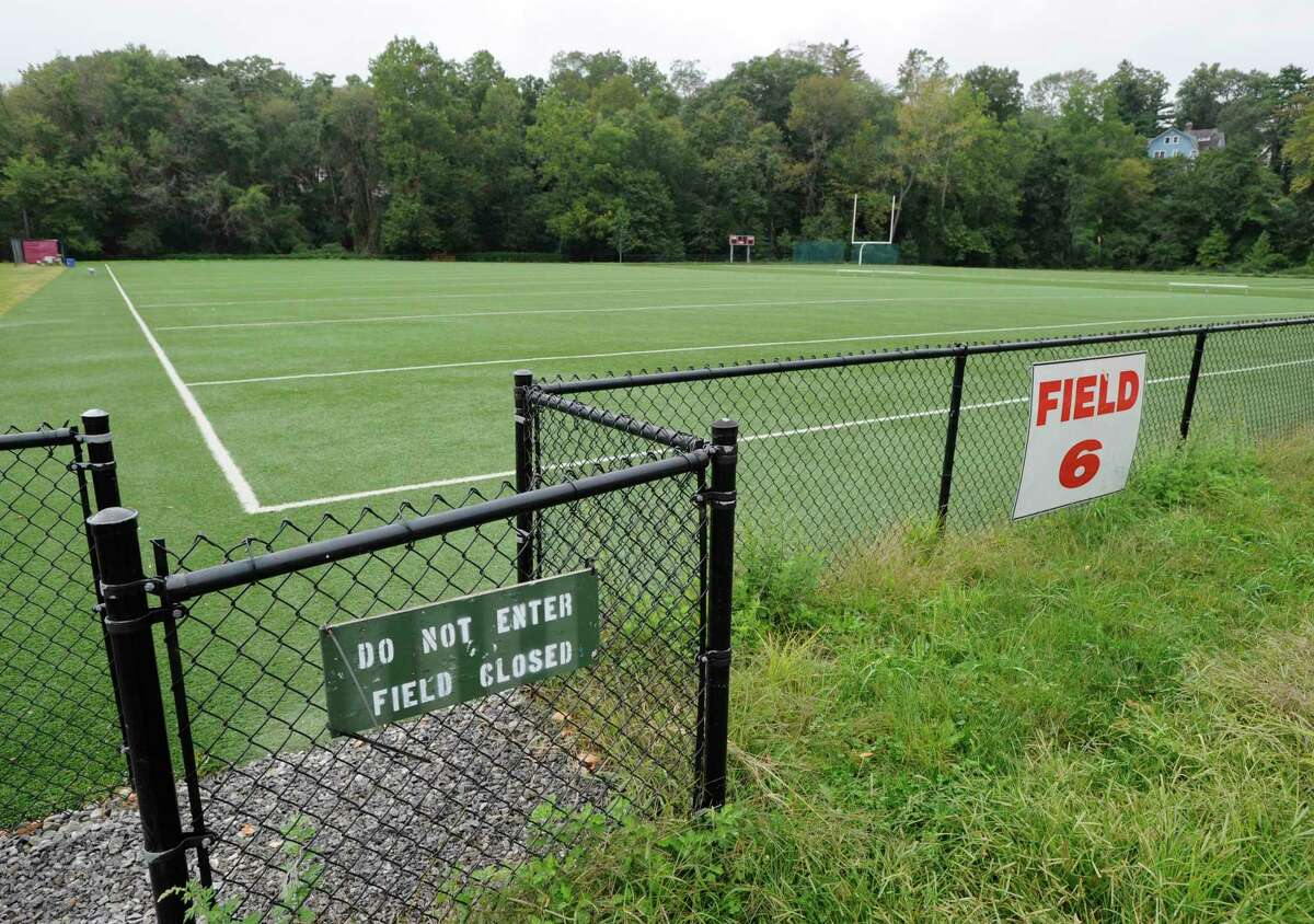 A sing warns athletic field six is closed at Greenwich High School Tuesday Sept. 20, 2011. Toxins unearthed during the school's project to build a new auditorium have closed all GHS athletic fields except the stadium field. The Representative Town Meeting voted Monday to approve nearly $1.2 million in funding to finance the cleanup of contaminated soil at Greenwich High School and replenish funds that have already been spent from the school's auditorium project budget in response to toxins found on school property.