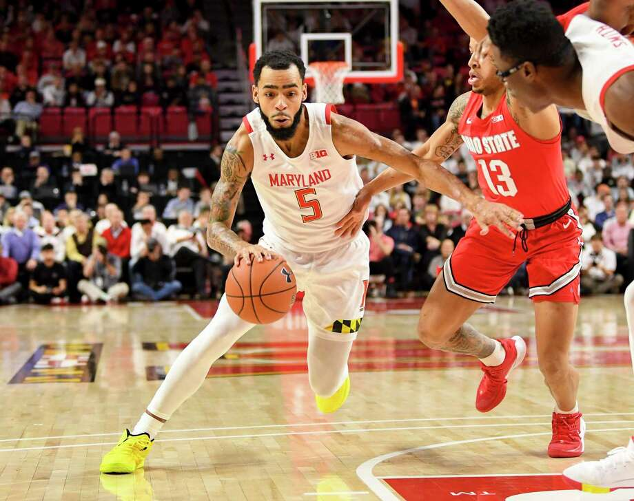 Maryland guard Eric Ayala drives to the basket against Ohio State guard CJ Walke. Photo: Washington Post Photo By Jonathan Newton / The Washington Post