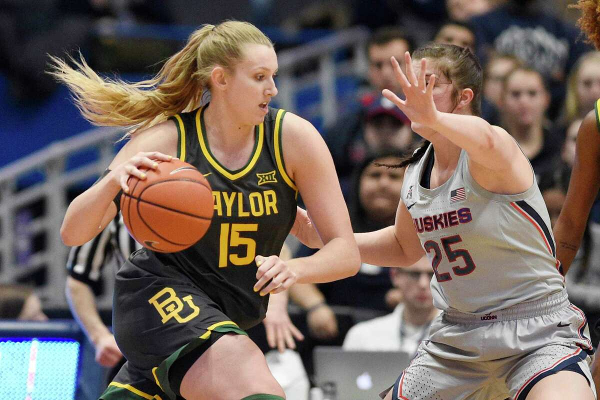 Baylor's Lauren Cox, left, is guarded by UConn's Kyla Irwin in the second half of last week's game in Hartford.