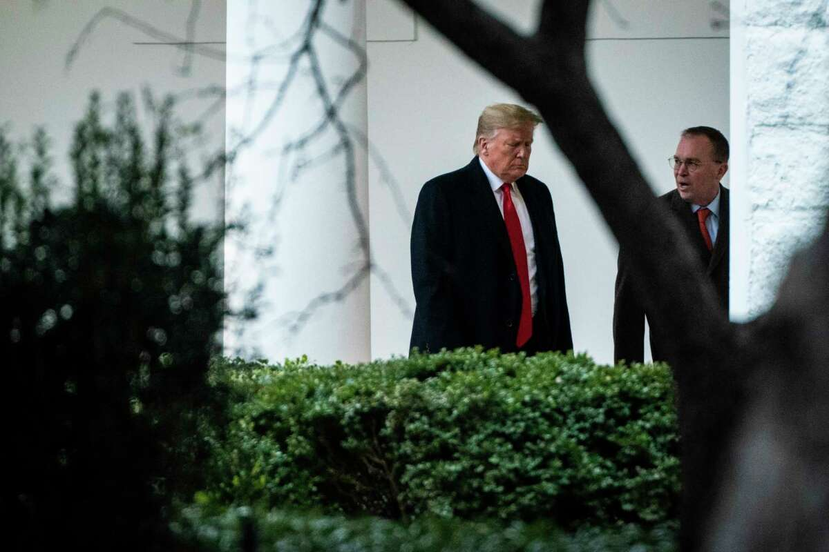President Donald Trump walks with acting White House Chief of Staff Mick Mulvaney on Jan. 13, 2020, in Washington, D.C.
