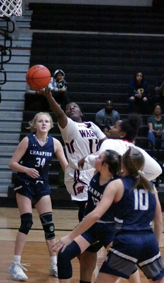 Wagner's Kieundria Dorsey (11) lays up a basket for two of her 17 points in their 72-55 home win over Boerne Champion on Friday. Photo: Lavon Brown /Contributor