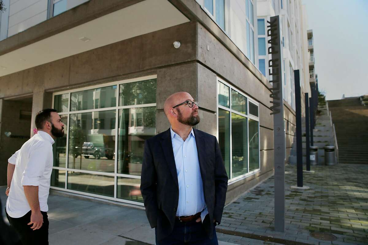 Supervisor Rafael Mandelman stands next to the Openhouse Community building. Openhouse will oversee a housing project bringing 100 units to San Francisco's District 8.