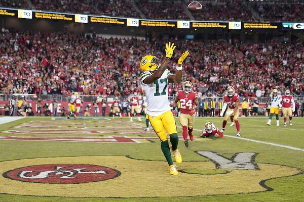 SANTA CLARA, CALIFORNIA - NOVEMBER 24: Davante Adams #17 of the Green Bay Packers catches a pass for a two-point conversion against the San Francisco 49ers during the second half at Levi's Stadium on November 24, 2019 in Santa Clara, California. ~~
