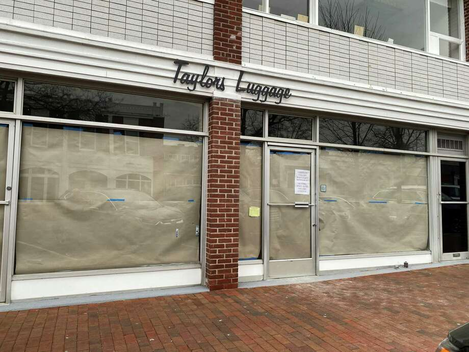 Two New Canaan businesses — Taylor's Luggage and Nantucket Monogram — are merging, according to a sign on the window of Taylor's Luggage. The pictures were taken Friday, Jan. 10, 2020. Photo: Grace Duffield / Hearst Connecticut Media
