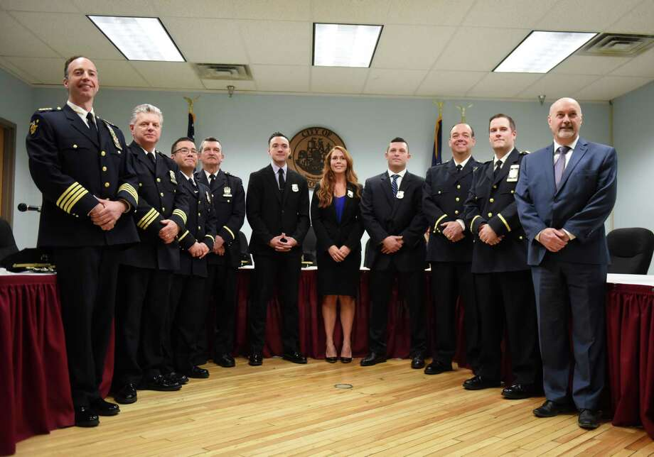 Newly sworn-in Troy Police officers; Nathaniel R. Casey, center left, Kayla B. DeCelle and Dunea J. Lockwood, center right, are joined by Mayor Patrick Madden, right, and senior members of the Troy Police Department during a swearing-in ceremony for the three new officers on Monday, Jan. 13, 2020, at City Hall in Troy, N.Y. (Will Waldron/Times Union) Photo: Will Waldron / 40048609A
