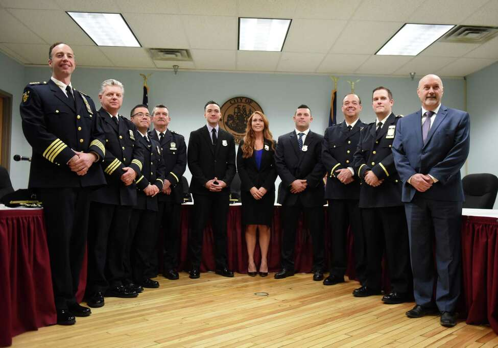 Newly sworn-in Troy Police officers; Nathaniel R. Casey, center left, Kayla B. DeCelle and Dunea J. Lockwood, center right, are joined by Mayor Patrick Madden, right, and senior members of the Troy Police Department during a swearing-in ceremony for the three new officers on Monday, Jan. 13, 2020, at City Hall in Troy, N.Y. (Will Waldron/Times Union)