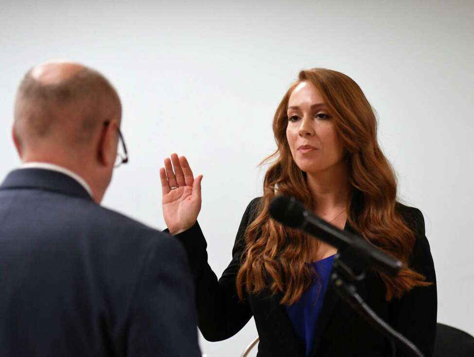 Troy Police Officer Kayla B. DeCelle is sworn-in by Mayor Patrick Madden during a ceremony on Monday, Jan. 13, 2020, at City Hall in Troy, N.Y. (Will Waldron/Times Union)
