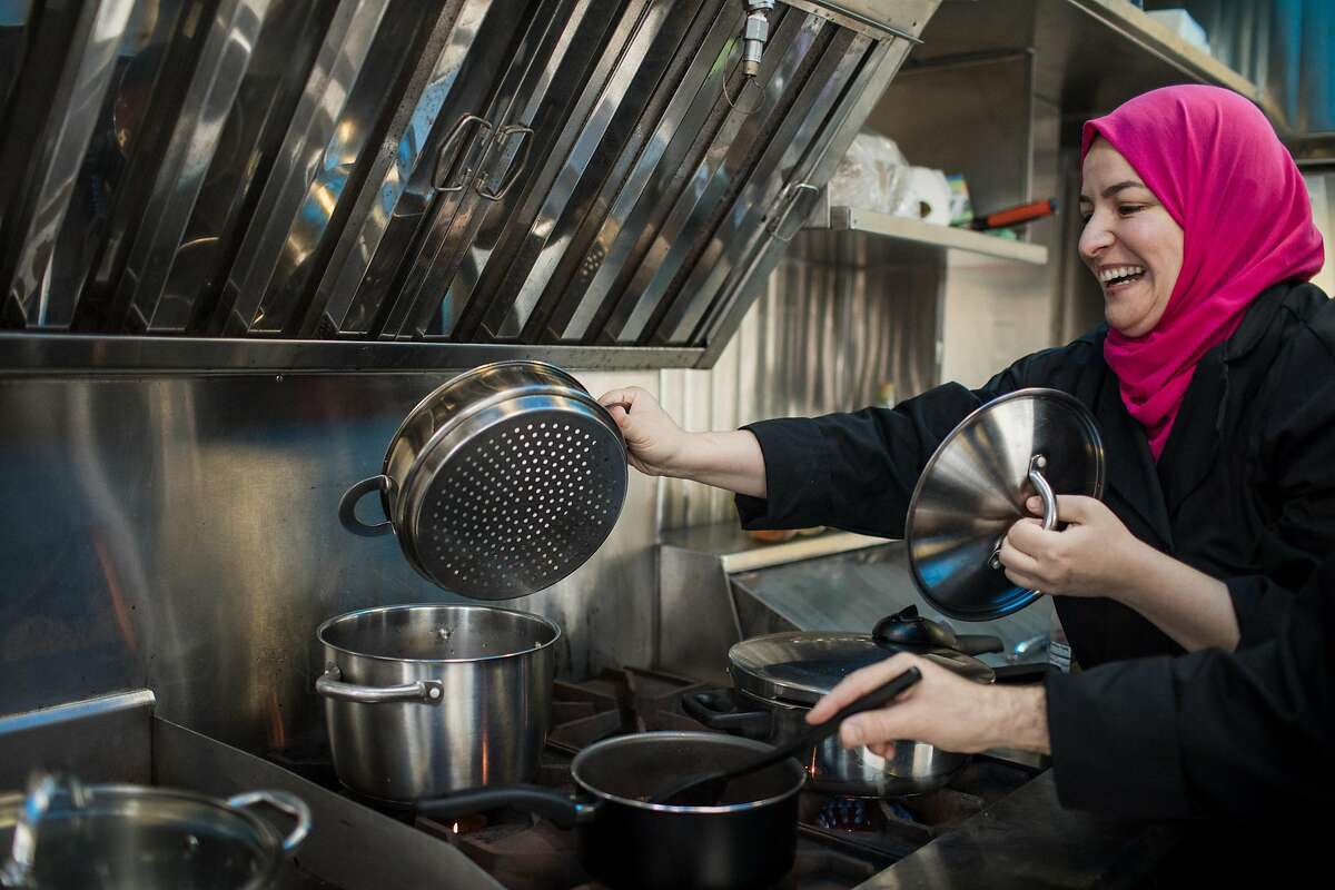 Wafa Bahloul shows the cooking substitute she uses to make cous cous at her Algerian food truck, Kayma on December 22, 2019 on Treasure Island in San Francisco, California.