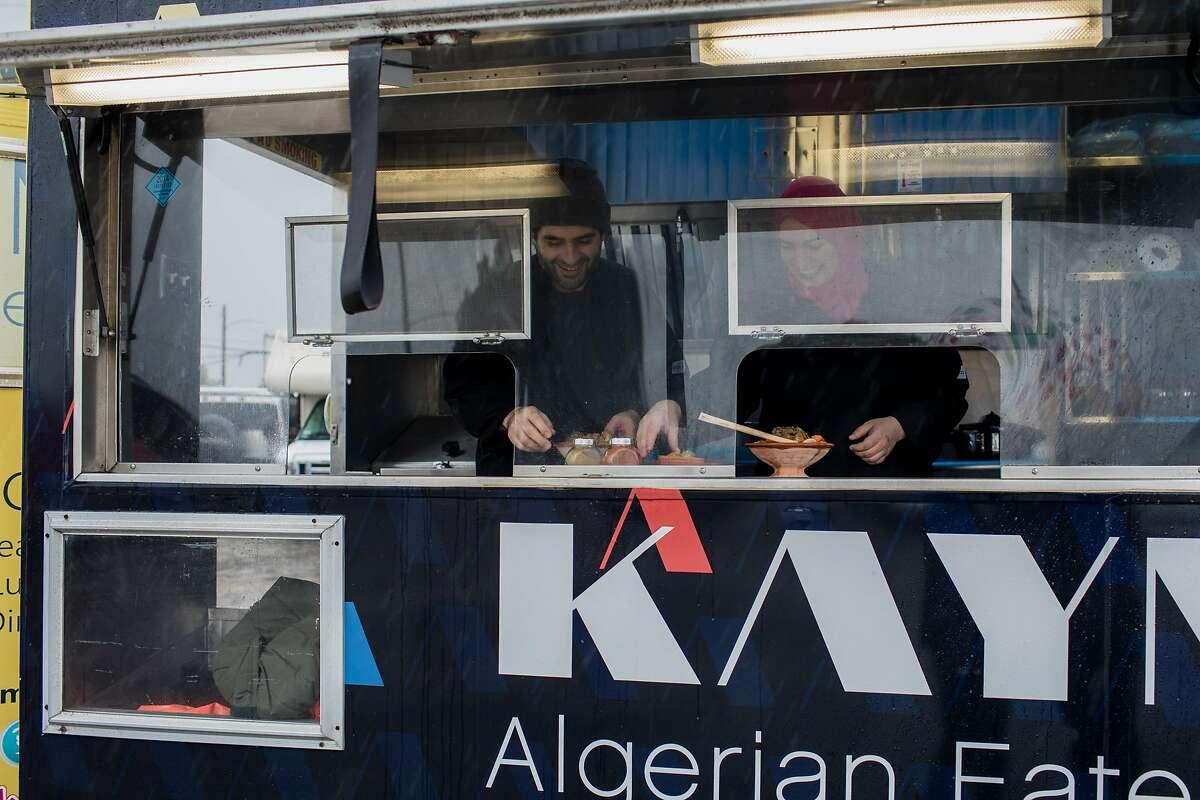 Wafa and Mounir Bahloul at their Algerian food truck, Kayma on December 22, 2019 on Treasure Island in San Francisco, California.