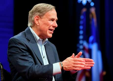 """Texas Gov. Greg Abbott answers questions during an August town hall. Texas' 16 Catholic bishops Monday called Gov. Greg Abbott's decision to reject resettlement of new refugees """"deeply discouraging and disheartening,"""" joining other religious and secular groups pressing the governor to reconsider."""