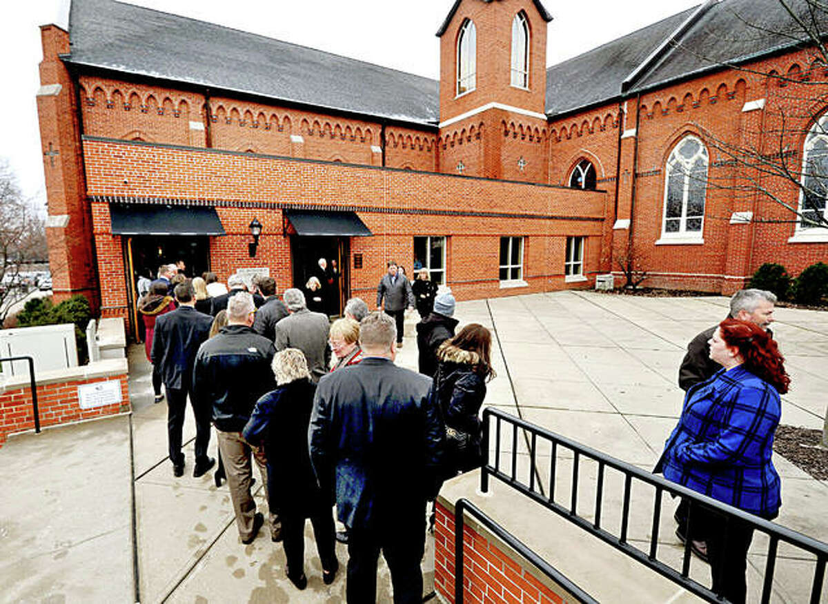 A crowd of people line up to pay their respects at St. Boniface Catholic Church on Monday in Edwardsville during a public visitation of slain prominent Edwardsville attorney Randy L. Gori.