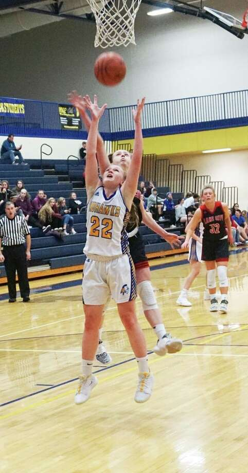 Morley Stanwood sophomore Madison Garbow goes for an offensive layup during her team's 54-49 win over Lake City on Monday night. (Pioneer photo/Joe Judd)