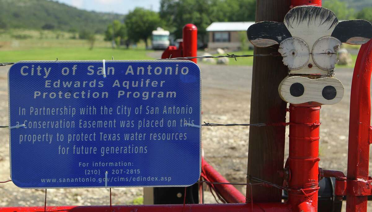 The owners of Marneldo Ranch near Sabinal in Medina County decided to participate in the City of San Antonio's Edwards Aquifer Protection Program, which buys development rights from property owners in order to keep the land close to its natural state. A sign by the gate lets visitors know about the program.