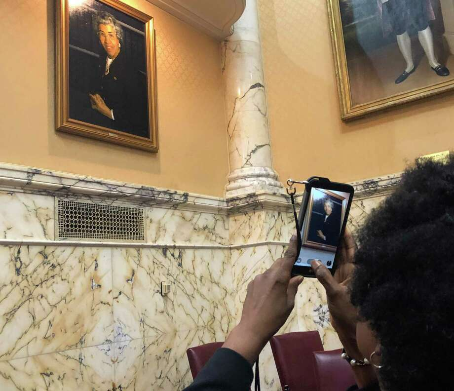 Sen. Mary Washington, D-Baltimore City, photographs the newly-unveiled portrait of the late Verda Mae Freedom Welcome, the first black woman in U.S. history elected to serve in a state senate. Photo: Washington Post Photo By Erin Cox / The Washington Post
