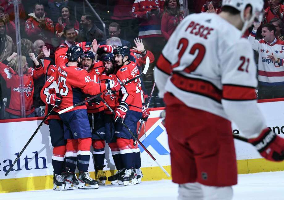 Washington Capitals left wing Alex Ovechkin is congratulated by his teammates after scoring during the first period against the Carolina Hurricanes at Capital One Arena in Washington on Monday, Jan. 13, 2020. Photo: Washington Post Photo By Toni L. Sandys / The Washington Post