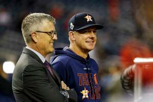 Astros general manager Jeff Luhnow and Houston Astros manager AJ Hinch (14) talk before Game 4 of the World Series at Nationals Park in Washington, D.C. on Saturday, Oct. 26, 2019.