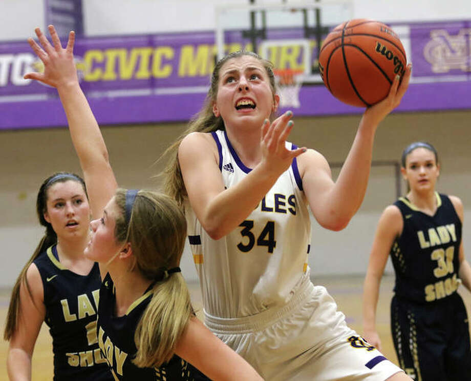 CM's Jackie Woelfel (34) shoots over a Teutopolis defender in the lane during the third quarter Monday night in Bethalto. Photo: Greg Shashack | The Telegraph