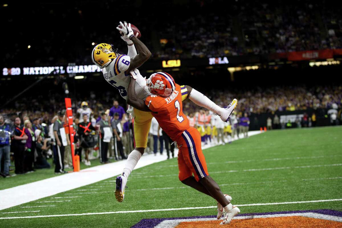 NEW ORLEANS, LOUISIANA - JANUARY 13: Terrace Marshall Jr. #6 of the LSU Tigers scores a touchdown against Clemson Tigers in the College Football Playoff National Championship game at Mercedes Benz Superdome on January 13, 2020 in New Orleans, Louisiana. (Photo by Chris Graythen/Getty Images)